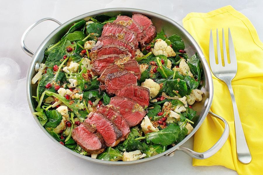 Recipe: Beef Tenderloin with Roasted Cauliflower-Pomegranate Salad image
