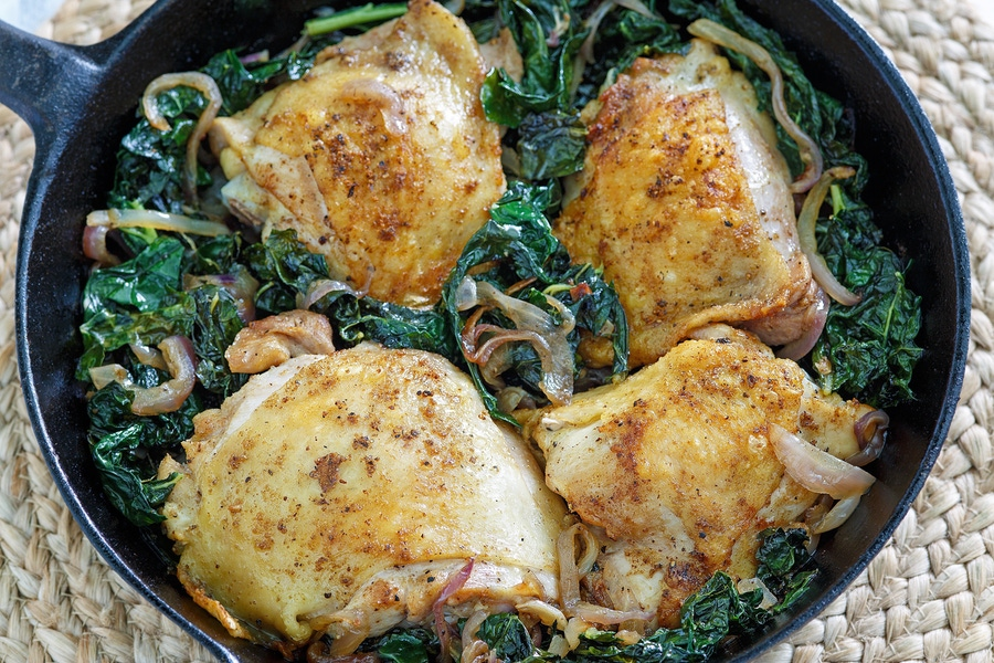 https://thepaleodiet.imgix.net/images/Crispy-Chickien-Thighs-with-Kale-Red-Onion_FINAL02.jpg?auto=compress%2Cformat&fit=clip&q=95&w=900
