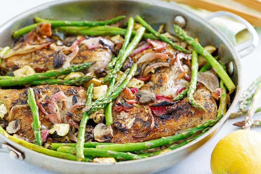 https://thepaleodiet.imgix.net/images/Roasted-Chicken-with-Spring-Veggie-side.png?auto=compress%2Cformat&crop=focalpoint&fit=crop&fp-x=0.5&fp-y=0.5&q=95&w=900