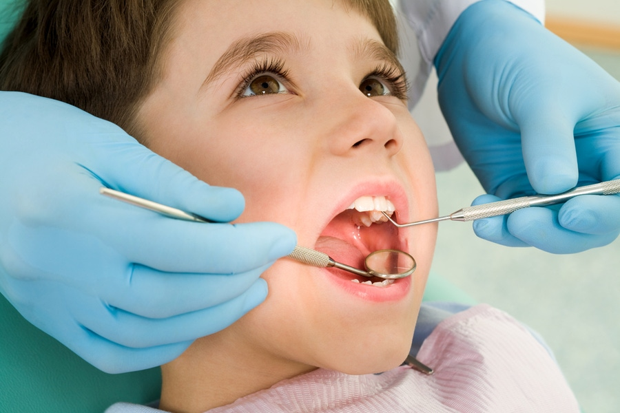 https://thepaleodiet.imgix.net/images/child-at-dentist-shutterstock_28933948.jpg?auto=compress%2Cformat&fit=clip&q=95&w=900