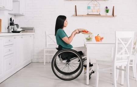 Woman cooking in a wheelchair