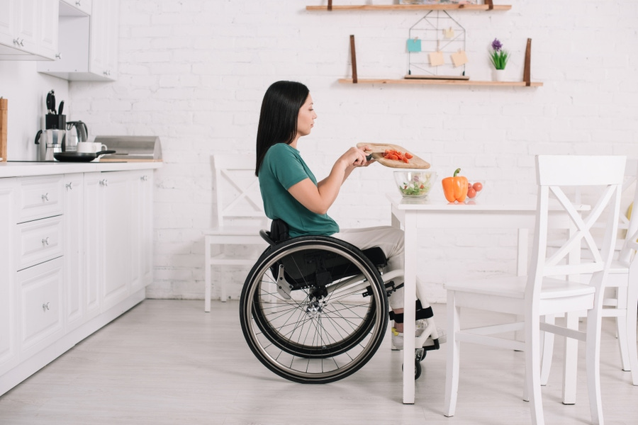 https://thepaleodiet.imgix.net/images/woman-cooking-in-a-wheelchair.jpg?auto=compress%2Cformat&fit=clip&q=95&w=900